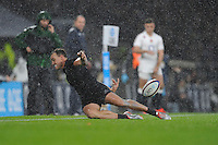Israel Dagg of New Zealand stops the ball from going into touch during the QBE International match between England and New Zealand at Twickenham Stadium on Saturday 8th November 2014 (Photo by Rob Munro)