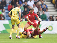 Wales's William Harries is tackled by Australia's Sean McMahon<br /> <br /> Australia Vs Wales - Men's quarter-final<br /> <br /> Photographer Chris Vaughan/CameraSport<br /> <br /> 20th Commonwealth Games - Day 4 - Sunday 27th July 2014 - Rugby Sevens - Ibrox Stadium - Glasgow - UK<br /> <br /> © CameraSport - 43 Linden Ave. Countesthorpe. Leicester. England. LE8 5PG - Tel: +44 (0) 116 277 4147 - admin@camerasport.com - www.camerasport.com