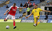 Fleetwood Town's Nathan Sheron gets a shot away whilst under pressure from Oxford United's Marcus Browne<br /> <br /> Photographer David Shipman/CameraSport<br /> <br /> The EFL Sky Bet League One - Oxford United v Fleetwood Town - Saturday August 11th 2018 - Kassam Stadium - Oxford<br /> <br /> World Copyright &copy; 2018 CameraSport. All rights reserved. 43 Linden Ave. Countesthorpe. Leicester. England. LE8 5PG - Tel: +44 (0) 116 277 4147 - admin@camerasport.com - www.camerasport.com