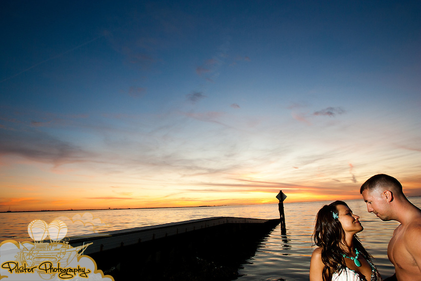 Erika Donaldson and Lee Bugay during their engagement session on Monday, January 23, 2012,  at Cypress Point Park in Tampa, Florida. Erika has always wanted to be a mermaid and Lee does regular fishing.  (Chad Pilster of http://www.PilsterPhotography.net)