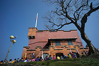 Taiwanese primary school students sit in front of an old building of the Santo Domingo City in Danshui District of Taipei, Taiwan, 2015. The Santo Domingo City was built by the Spanish colonialists in 1629.