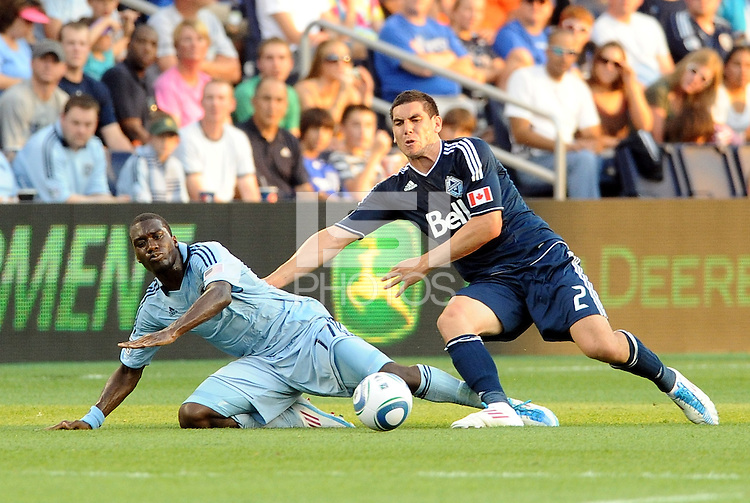 Sporting KC forward C.J Sapong (17) tassles for the ball with Vancouver Whitecaps defender Michael Boxall... Sporting KC defeated Vancouver Whitecaps 2-1 at LIVESTRONG Sporting Park, Kansas City, Kanas.