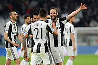 Calcio, Serie A: Juventus vs Milan. Torino, Juventus Stadium, 10 marzo 2017.<br /> Juventus&rsquo; Paulo Dybala, back to camera, celebrates with teammates Paulo Dybala, left, and Gonzalo Higuain, after scoring on a penalty kick the winning goal during the Italian Serie A football match between Juventus and AC Milan at Turin's Juventus Stadium, 10 March 2017. Juventus won 2-1.<br /> UPDATE IMAGES PRESS/Manuela Viganti