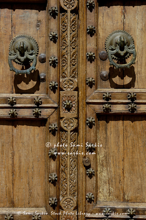 Typical Andalusian-style wooden studded door, Tarifa, Andalusia, Spain.