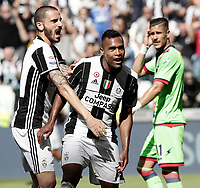 Calcio, Serie A: Juventus vs Crotone. Torino, Juventus Stadium, 21 maggio 2017.<br /> Juventus&rsquo; Alex Sandro, right, is hugged by his teammate Leonardo Bonucci after scoring during the Italian Serie A football match between Juventus and Crotone at Turin's Juventus Stadium, 21 May 2017. Juventus defeated Crotone 3-0 to win the sixth consecutive Scudetto.<br /> UPDATE IMAGES PRESS/Isabella Bonotto