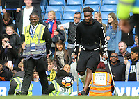 Callum Hudson-Odoi of Chelsea can't resist kicking a ball as he walks onto the pitch on his crutches at the final whistle during Chelsea vs Watford, Premier League Football at Stamford Bridge on 5th May 2019