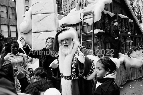 New York, New York<br /> November 26, 2009<br /> USA<br /> <br /> Following the Macy's Thanksgiving Day Parade in mid-town Manhattan, Santa Claus comes down off his sleigh/foat on 7th Avenue following many children's cartoon character balloons, all marking the beginning of the Christmas season.
