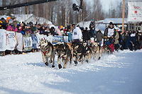 Mike Williams Jr.  runs down the chute leaving the restart of the Iditarod sled dog race at Willow, Alaska  Sunday, March 3, 2013.