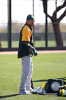 Coco Crisp #4 of the Oakland Athletics participates in spring training workouts at the Athletics complex on February 23, 2011  in Phoenix, Arizona. .Photo by:  Bill Mitchell/Four Seam Images.