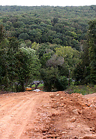 NWA Democrat-Gazette/DAVID GOTTSCHALK  The view looking west Tuesday, September 5, 2017, a backhoe near the top of the haul road for the Winslow Dirt Pit off of U.S. 71 in Winslow. The Washington County Road Department is currently building the road near 18264 U.S. 71 to have access to the approved pit.