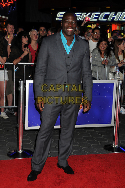 """Adewale Akinnuoye-Agbaje.""""The Thing"""" World Premiere held at AMC Citywalk Stadium 19, Universal City, California, USA..October 10th, 2011.full length suit grey gray turquoise shirt.CAP/ADM/BP.©Byron Purvis/AdMedia/Capital Pictures."""