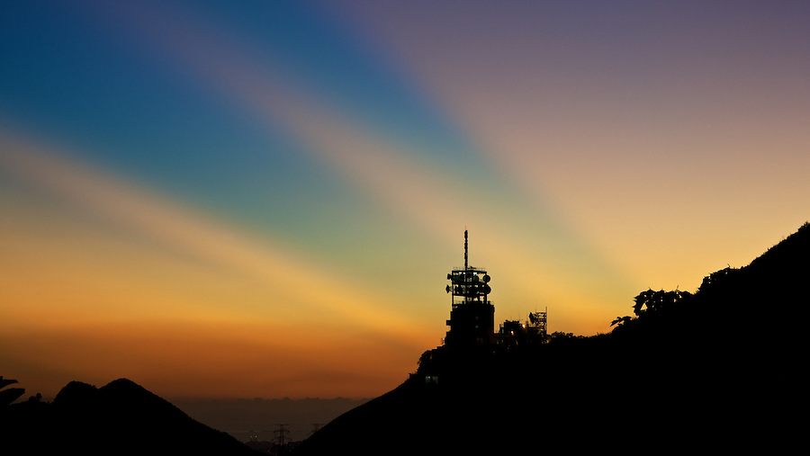 The Sun Sets Behind Temple Hill Transmission Station, Kowloon, Hong Kong.