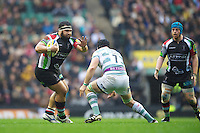 James Johnston of Harlequins hands off Jebb Sinclair of London Irish during the Aviva Premiership match between Harlequins and London Irish at Twickenham on Saturday 29th December 2012 (Photo by Rob Munro).