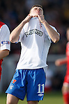 Dejection from Fraser Aird after he cracks a shot narrowly wide