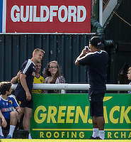Troy Deeney of Watford takes photos of Matej Vydra for fans during the Pre Season Friendly match between Woking and Watford at the Kingfield Stadium, Woking, England on 10 July 2016. Photo by Andy Rowland.