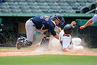 Tampa Yankees catcher Tyson Blaser (57) tags Austin Nola (14) sliding into home during a game against the Jupiter Hammerheads on July 18, 2013 at Roger Dean Stadium in Jupiter, Florida.  Jupiter defeated Tampa 6-1.  (Mike Janes/Four Seam Images)