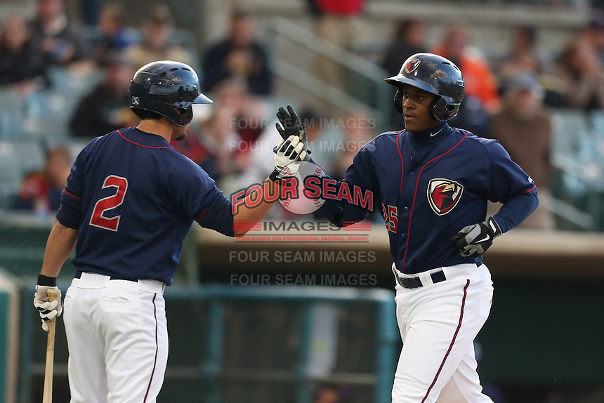 Ronnie Mitchell (25) of the Lancaster JetHawks is greeted by teammate Jack Mayfield (2) after hitting a home run during a game against the Modesto Nuts at The Hanger on April 25, 2015 in Lancaster, California. Lancaster defeated Modesto, 5-4. (Larry Goren/Four Seam Images)