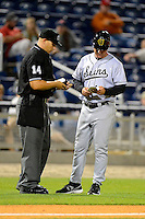 Jacksonville Suns manager Andy Barkett #17 makes changes with umpire John Bostwick during a game against the Pensacola Blue Wahoos on April 15, 2013 at Pensacola Bayfront Stadium in Pensacola, Florida.  Jacksonville defeated Pensacola 1-0 in 11 innings.  (Mike Janes/Four Seam Images)