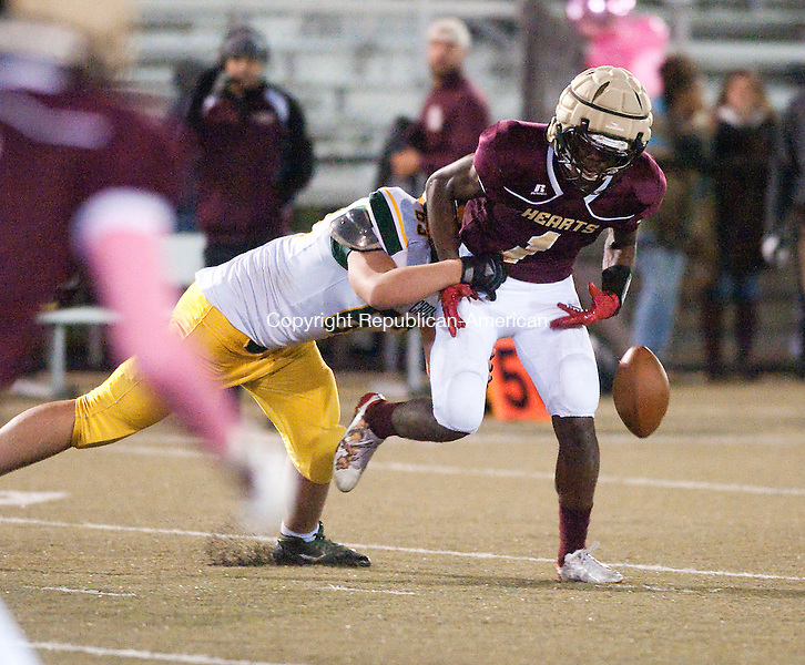 WATERBURY,  CT-102816JS06- Holy Cross's Manny Diorio (63) forces  fumble while pulling down Sacred Heart-Kaynor Tech's Trey Dawson (1) during their game Friday at Municipal Stadium in Waterbury.<br />  Jim Shannon Republican American