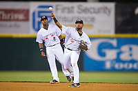 Hickory Crawdads second baseman Andy Ibanez (7) makes a throw to first base as shortstop Yeyson Yrizarri (2) looks on during the game against the Rome Braves at L.P. Frans Stadium on May 12, 2016 in Hickory, North Carolina.  The Braves defeated the Crawdads 3-0.  (Brian Westerholt/Four Seam Images)