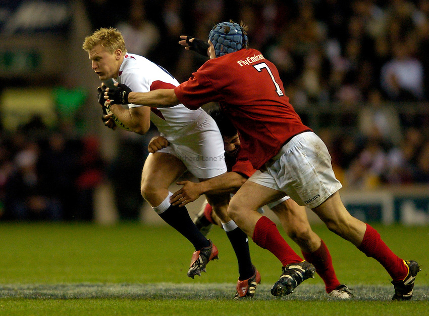 Photo: Richard Lane..England XV v New Zealand Barbarians. Zurich World Champions Challenge. 20/12/2003..Stuart Abbott attacks as Keith Powen and Josh Blackie tackle.