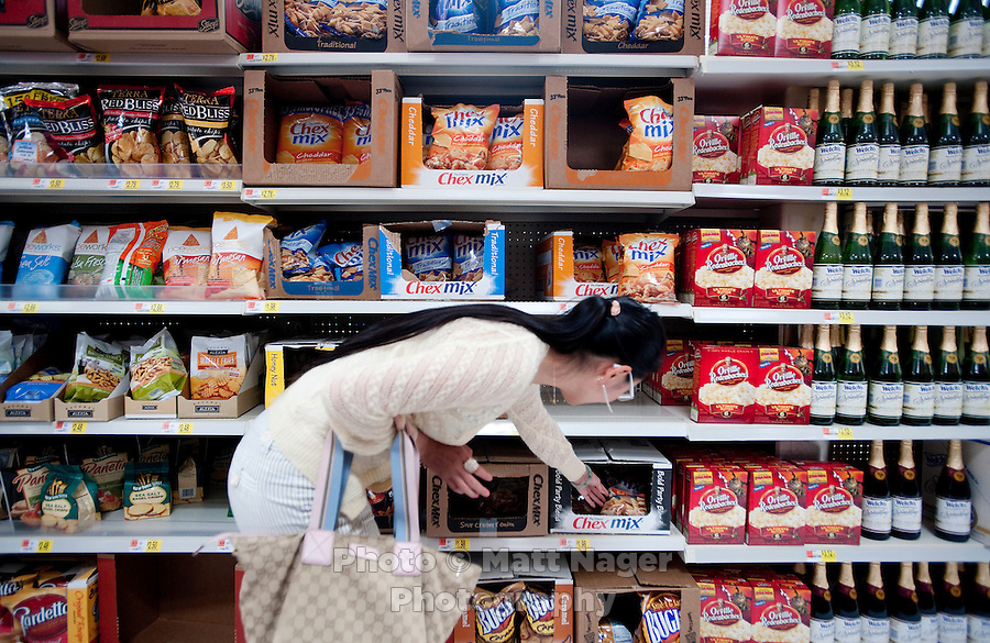 """Yue Zheng (cq, left) shops for snacks at a WalMart in Lawton, Oklahoma, April 29, 2010. Zheng is adapting to life in the US after two years of teaching high school Chinese as part of a """"guest teacher"""" program...PHOTO/ MATT NAGER"""