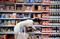"Yue Zheng (cq, left) shops for snacks at a WalMart in Lawton, Oklahoma, April 29, 2010. Zheng is adapting to life in the US after two years of teaching high school Chinese as part of a ""guest teacher"" program...PHOTO/ MATT NAGER"