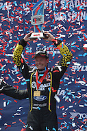 Washington, DC - June 22, 2014: Patrik Sandell raises the first place trophy after winning the 3rd Round of the Red Bull Global Rallycross on the grounds of RFK Stadium in the District of Columbia, June 22, 2014.   (Photo by Don Baxter/Media Images International)