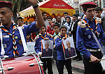 Palestinian scouts hold posters of Palestinian President Mahmoud Abbas during a Fatah rally in support of Abbas in the West Bank city of Nablus April 2, 2014. Abbas said he had begun steps to join several UN agencies, abandoning a pledge to freeze such action for the duration of peace talks which end in just four weeks. Photo by Nedal Eshtayah