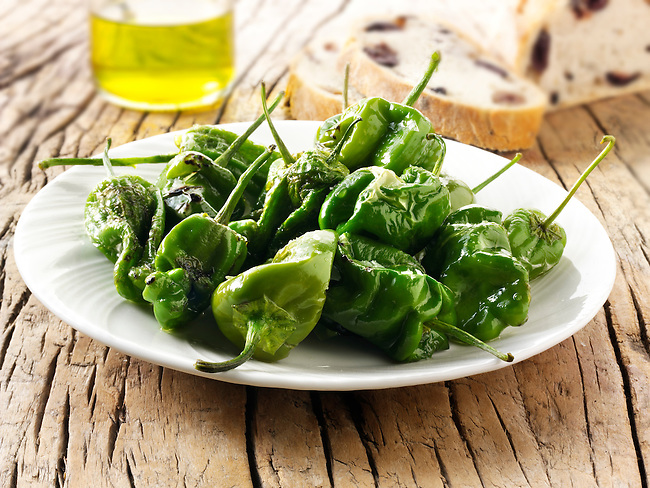 Whole griddled Padron peppers snack with sea salt