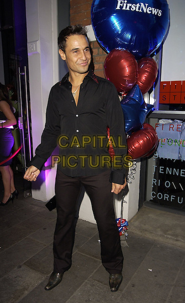 CHICO SLIMANI.First News - launch party at Fire & Stone, Covent Garden, London, UK..May 4th, 2006.Ref: CAN.full length black trousers shirt.www.capitalpictures.com.sales@capitalpictures.com.©Capital Pictures
