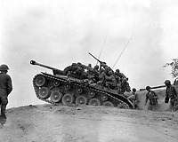 Men of the 9th Inf. Regt. man an M-26 tank to await an enemy attempt to cross the Naktong River.  September 3, 1950. Cpl. Thomas Marotta.  (Army)<br /> NARA FILE #:  111-SC-347856<br /> WAR & CONFLICT BOOK #:  1421
