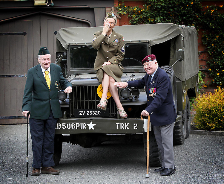 Dad's Army Launch..World War II veterans, Captain James Riordan (left) and Ex Sergeant Johnny Wetherall decked in their uniforms and medals to pose with model Pippa O'Connor to launch DAD?S ARMY, a military vehicle and re-enactment show which will take place in the grounds of Leopardstown Park Hospital.