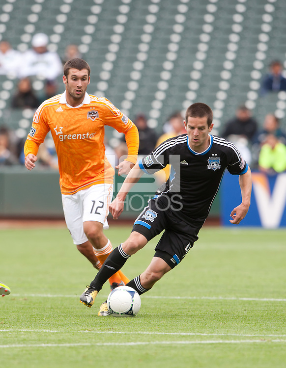 San Francisco, California - Saturday March 17, 2012: Sam Cronin dribbles the ball away from Will Bruim during the MLS match at AT&T Park. Houston Dynamo defeated San Jose Earthquakes  1-0