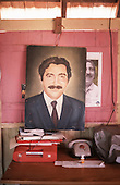 Xapuri, Acre State, Brazil. Painting of Chico Mendes at the Chico Mendes Foundation with telephone and typewriter.
