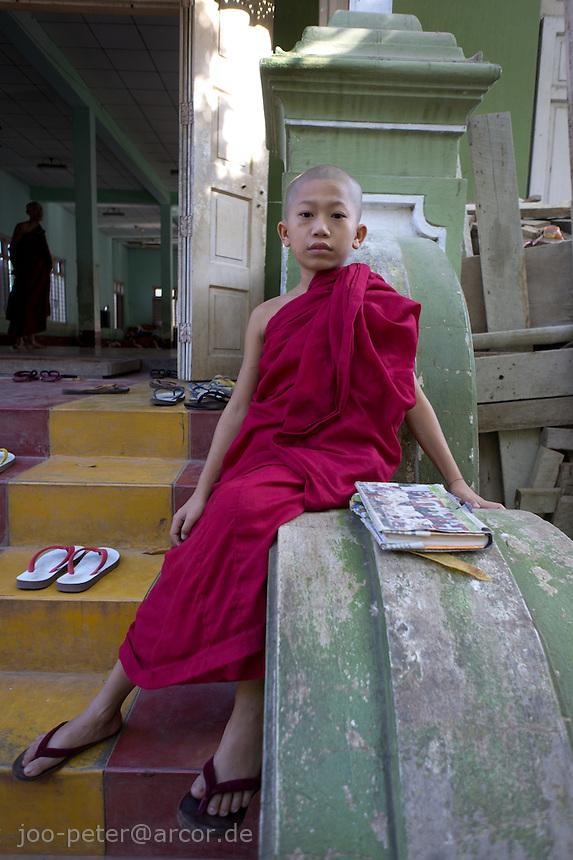 monk in monastery Ma Soe Yein Nu Kyaung, Mandalay, Myanmar, 2011
