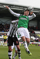 Matthew Doherty being challenged by Steven Thomson in the air in the St Mirren v Hibernian Clydesdale Bank Scottish Premier League match played at St Mirren Park, Paisley on 29.4.12.