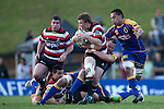 Dean Cummins gets tackled by Hayden Triggs. ITM Cup Round 1 game between the Counties Manukau Steelers and Otago, played at Bayer Growers Stadium, Pukekohe, on Saturday July 31st 2010. Counties Manukau Steelers won 29 - 13 after leading 22 - 6 at halftime.
