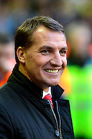 Sunday, 23 February 2014<br /> Pictured: Liverpool's Manager Brendan Rodgers smiles broadly before kick off<br /> Re: Barclay's Premier League, Liverpool FC v Swansea City FC v at Anfield Stadium, Liverpool Merseyside, UK.