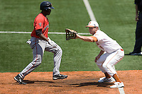 First baseman Tant Shepherd #9 of the Texas Longhorns receives a pick off attempt against Texas Tech on April 17, 2011 at UFCU Disch-Falk Field in Austin, Texas. (Photo by Andrew Woolley / Four Seam Images)