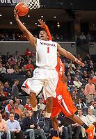 Feb. 2, 2011; Charlottesville, VA, USA; Virginia Cavaliers guard Jontel Evans (1) shoots in front of Clemson Tigers guard Demontez Stitt (2) during the game at the John Paul Jones Arena. Virginia won 49-47. Mandatory Credit: Andrew Shurtleff