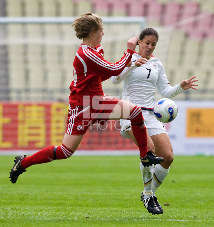 Sophie Schmidt of Canada and Shannon Boxx of the USA. The U.S. defeated Canada, 4-0, during the Four Nations Tournament in Guangzhou, China on January 16, 2008.