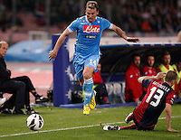 Naples's   Hugo Campagnaro challenged by Genoa 's   Luca Antonelli  during their Italian Serie A soccer match at the San Paolo  stadium in Naples April 7, 2013