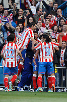 22.04.2012 MADRID, SPAIN - La Liga 11/12 match played between At. Madrid vs R.C.D. Espanyol (3-1) at Vicente Calderon stadium. the picture show  Atletico de Madrid players celebrating his team's goal
