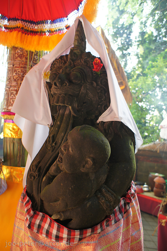 stone sculpture of a spirit connected to supreme devine witch Rangda, holy monkey forest, Ubud, Bali, archipelago Indonesia, 2010