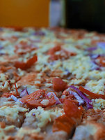 Focaccia bread with cheese, tomatoes, onions and garlic