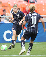 Rebecca Moros #19 passes to Lisa De Vanna #11 of the Washington Freedom  during a WPS match against ST. Louis Athletica on May 1 2010, at RFK Stadium, in Washington D.C. Freedom won 3-1.