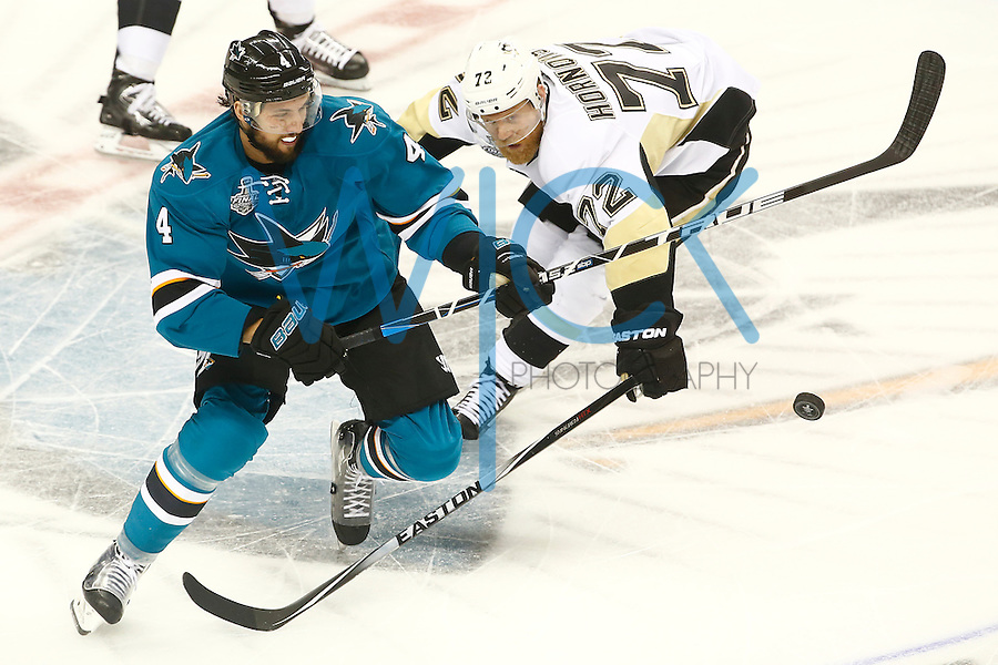 Patric Hornqvist #72 of the Pittsburgh Penguins and Brenden Dillon #4 of the San Jose Sharks chase after a loose puck in the third period during game four of the Stanley Cup Final at the SAP Center in San Jose, California on June 6, 2016. (Photo by Jared Wickerham / DKPS)