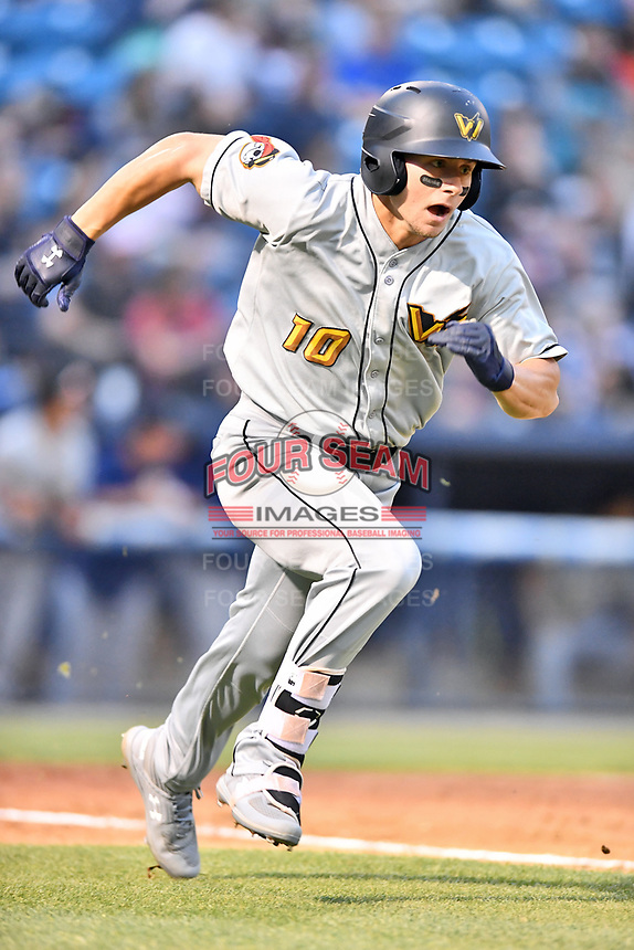 West Virginia Power center fielder Jarred Kelenic (10) runs to first base during a game against the Asheville Tourists at McCormick Field on April 18, 2019 in Asheville, North Carolina. The Power defeated the Tourists 12-7. (Tony Farlow/Four Seam Images)
