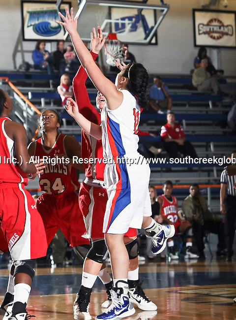 Texas - Arlington Mavericks guard Sabreena DeNure (11) shoots the ball  in the game between the UTA Mavericks and the  Nicholls State University Colonels  held at the University of Texas in Arlington's Texas Hall in Arlington, Texas. UTA defeats Nicholls 69 to 62